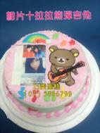 相片十拉拉熊彈吉他